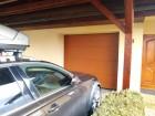 Sekční vrata UniTherm, design nedělený panel, barva hnědá RAL 8003